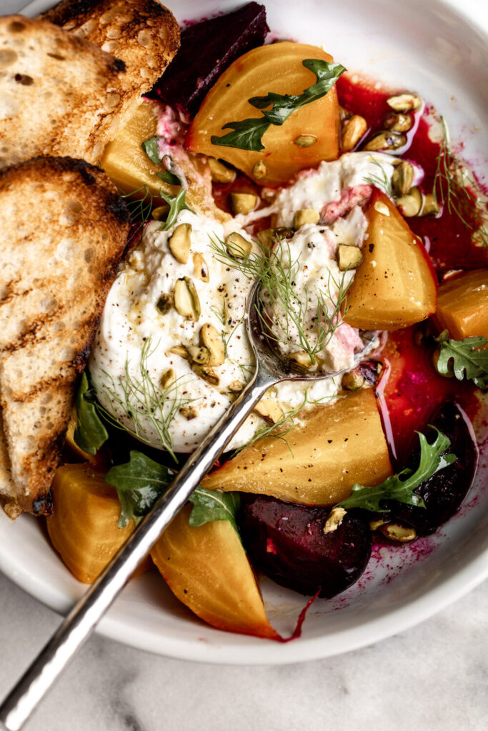 roasted red and yellow beets with burrata cheese and grilled bread with pistachios