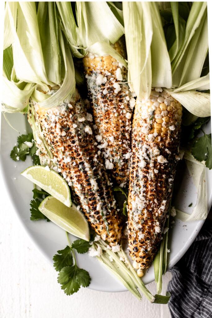 Spicy Charred Corn with Cilantro Aioli (Elote)   Fourth of July Menu Ideas