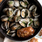 beer steamed clams in large staub with bread
