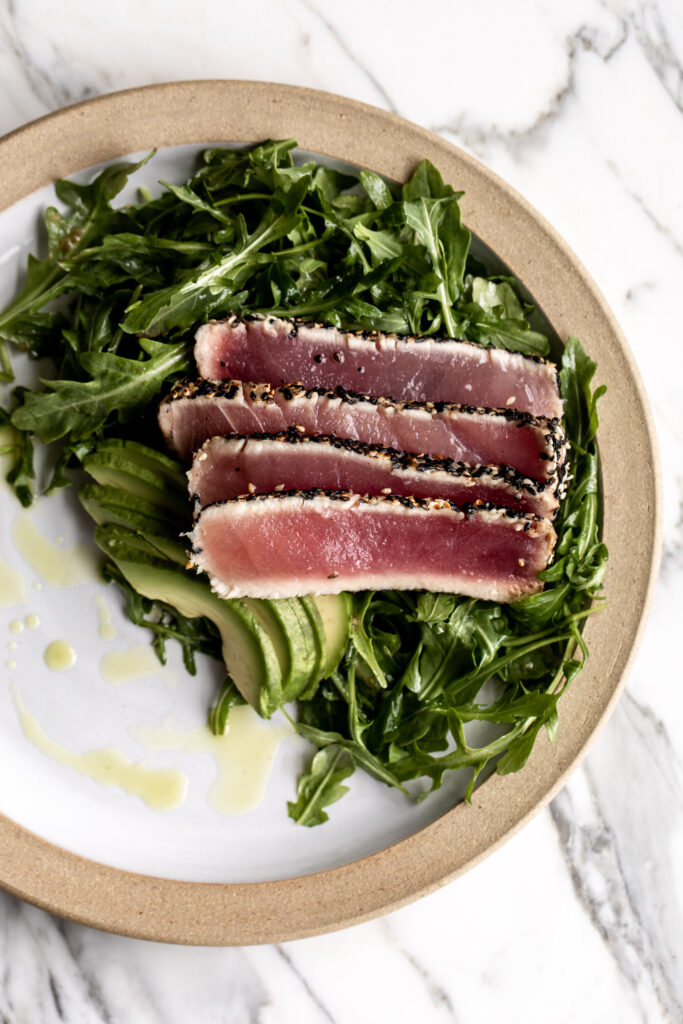 sesame crusted seared tuna with arugula