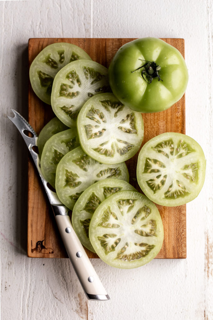 sliced green tomatoes on cutting board