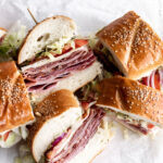 This Italian sub sandwich or hoagie is made with salami, prosciutto, mortadella, ham and capicola with provolone cheese on rolls.