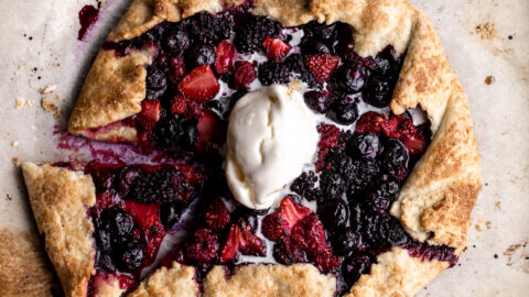 mixed berry galette with raspberries strawberries blueberries and blackberries in pastry dough