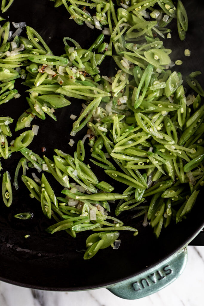 Sauté the shallots and peas