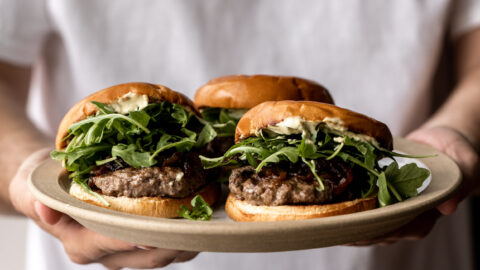 New Zealand Lamb Burgers with Curry Mayonnaise on a serving platter