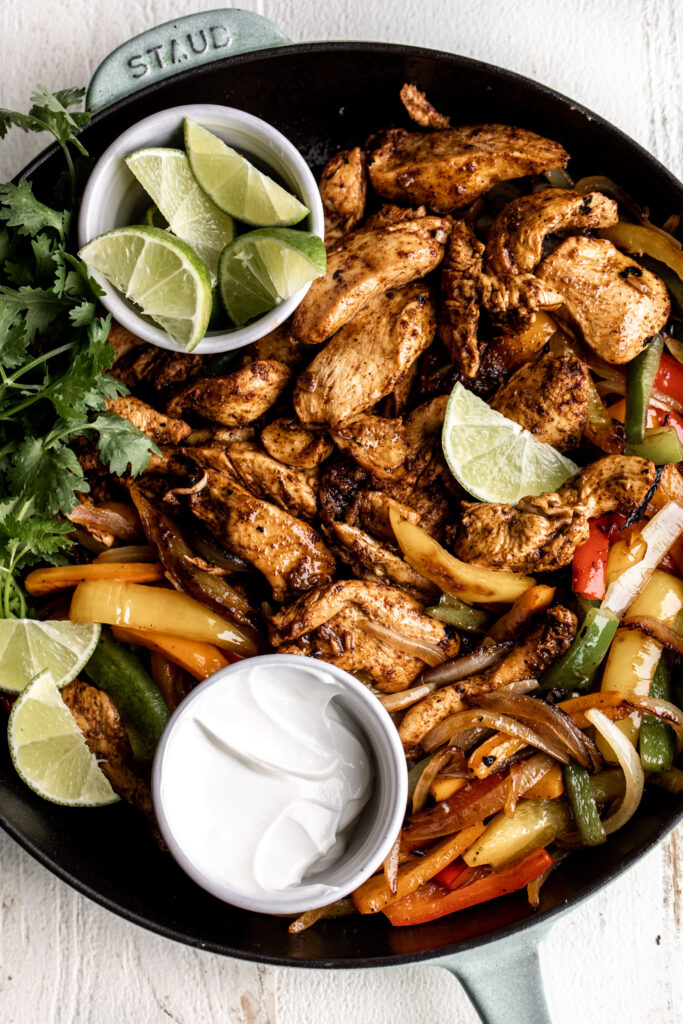 Strips of chicken breasts are marinated in tequila, lime and spices then sautéed and served with onions and peppers on flour tortillas.