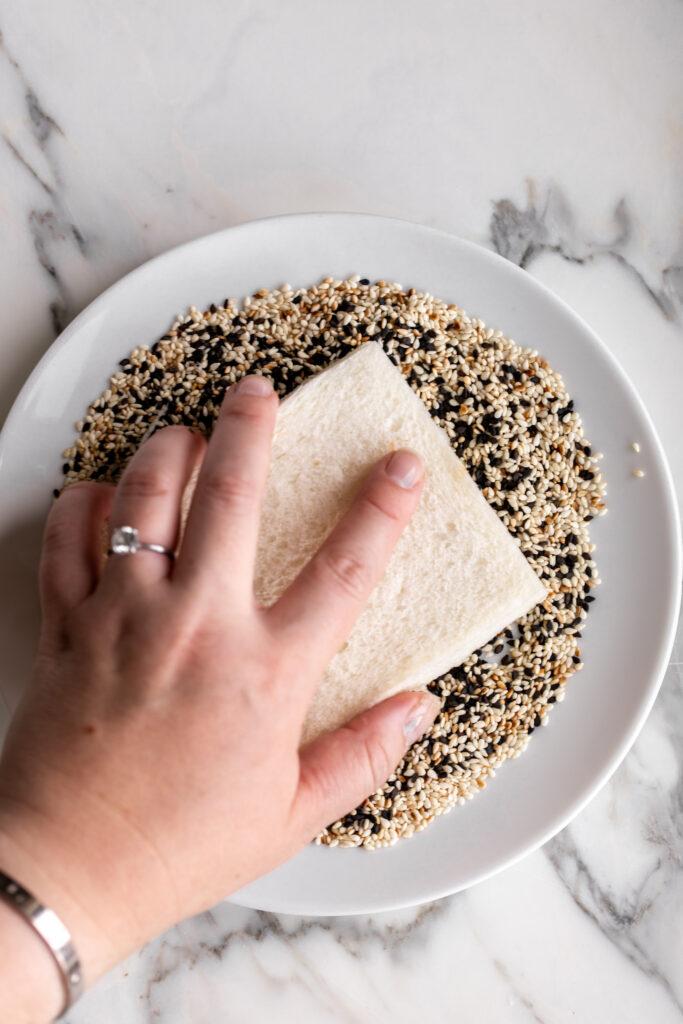 coating shrimp toast in sesame seeds