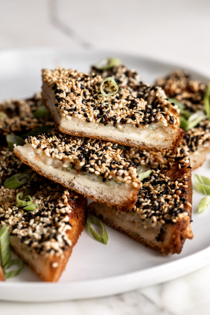 Chinese shrimp toast recipe made slices of bread covered in shrimp mousse and fried until crispy for an easy and flavorful appetizer.