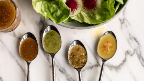 4 types of basic vinaigrette on spoons with butter lettuce salad