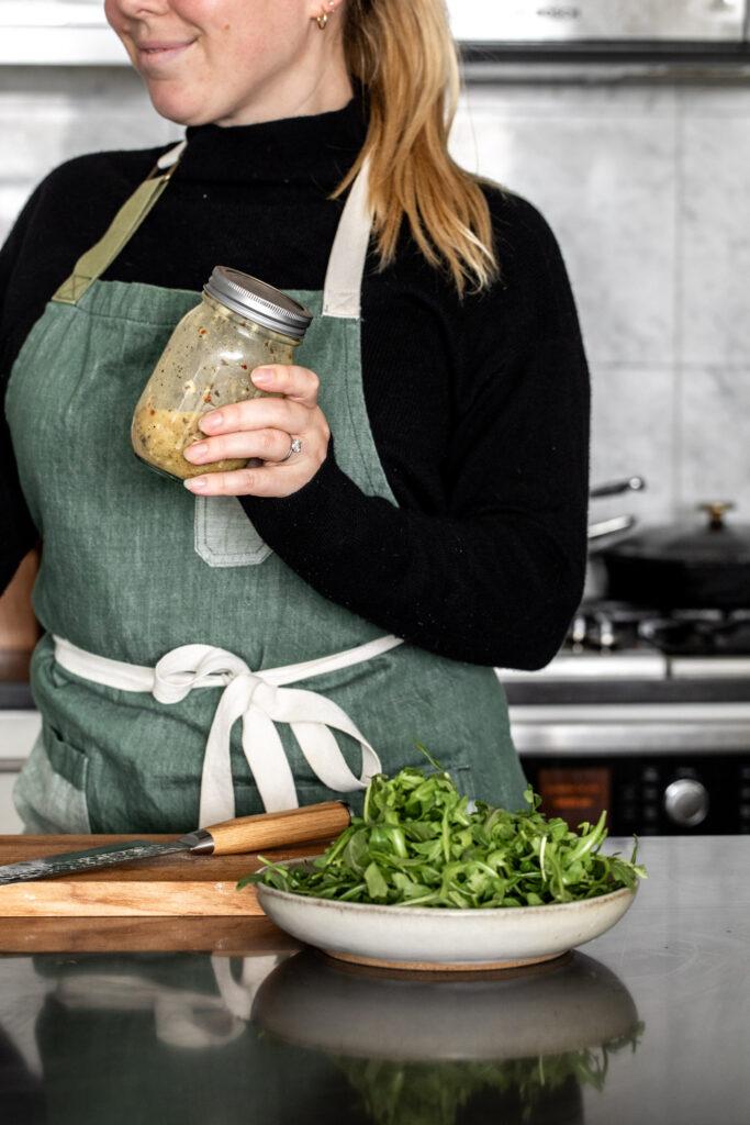 shake vinaigrette in a mason jar to emulsify with arugula salad
