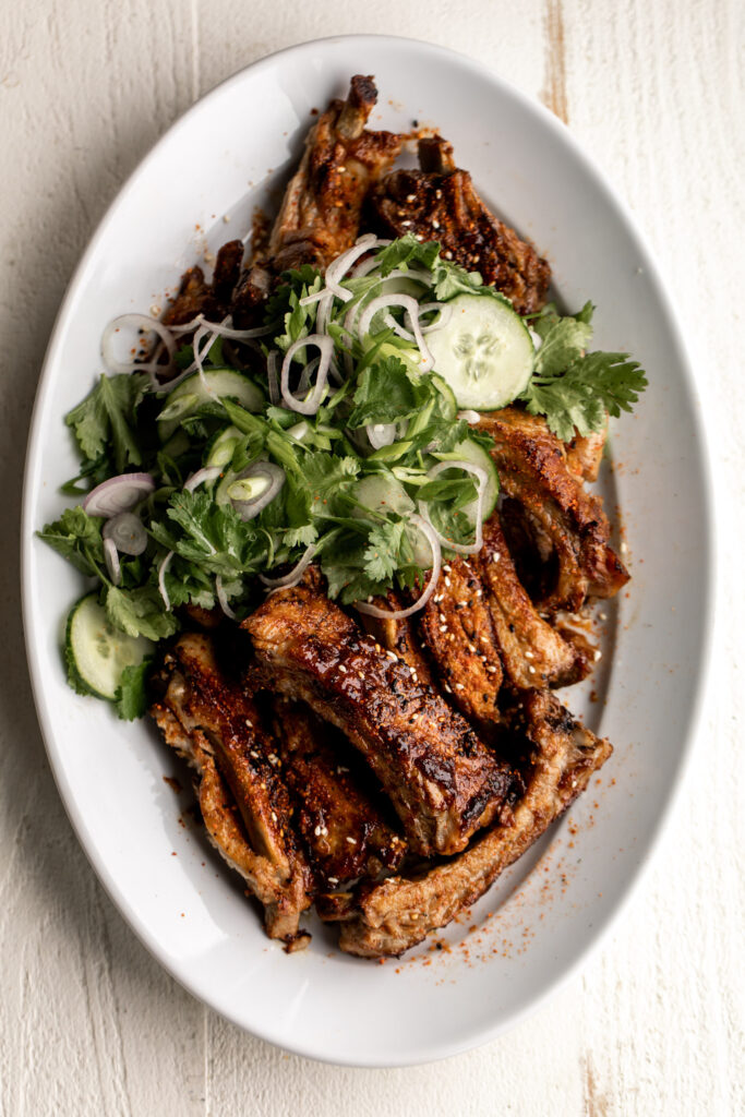 Togarashi Pork Ribs with Cucumber Herb Salad
